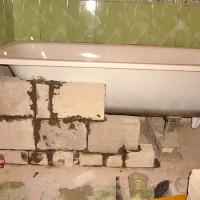 Как установить ванную на кирпичи