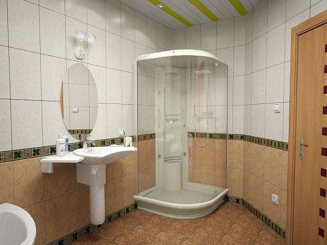 Угловая душевая в ванной комнате в хрущевке