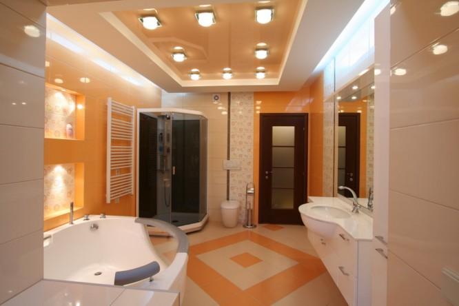 Оранжево бежевое оформление ванной