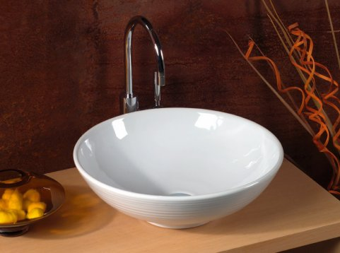 Круглые раковины прекрасно смотрятся в ванной