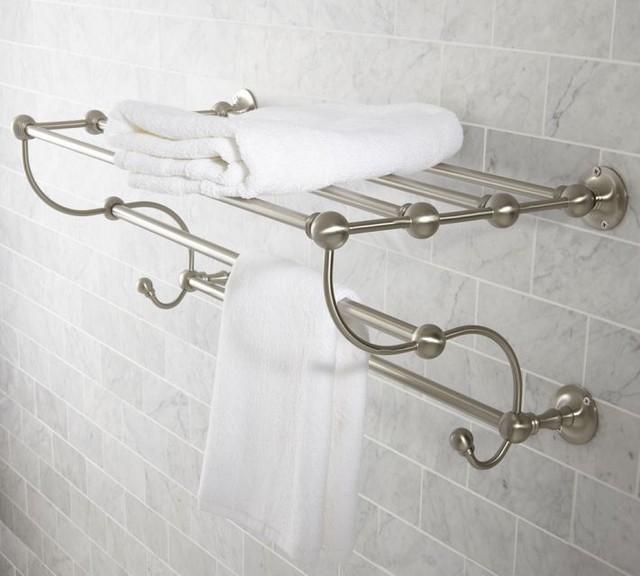 Место для хранения полотенец в ванной может стать изюминкой интерьера