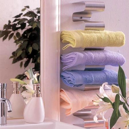 Вот еще несколько идей для хранения полотенец в ванной